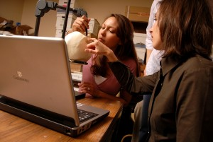 CHASS faculty member Ann Ross shows a student how to measure a skull. PHOTO BY ROGER WINSTEAD